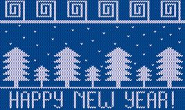 Knitted New Year Theme with Fir Trees and Snow on Blue. Knit fir tree forest in snowy weather Royalty Free Stock Photos