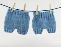 Knitted newborn pants Stock Photos
