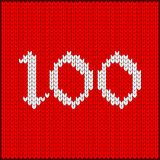 Knitted number one hundred. Figures one hundred as knitted pattern. Texture of jacquard sweater in Scandinavian style, white numerals. Decoration for postcard Stock Photo