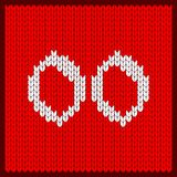 Knitted number two zeros. Figures two zeros as knitted pattern. Texture of jacquard sweater in Scandinavian style, white numerals. Decoration for postcard Stock Image