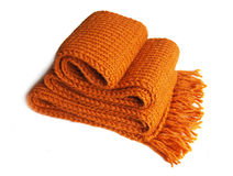 Knitted orange scarf. With fringe on white background Stock Image