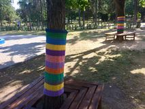 Ornaments for park trees. Knitted ornaments for tree trunks (yarnbombing) royalty free stock image