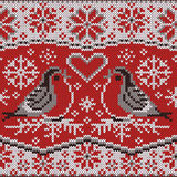 Knitted pattern with bullfinches Royalty Free Stock Photos