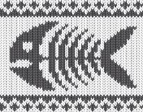 Knitted pattern with fish skeleton Royalty Free Stock Photo