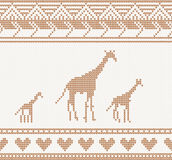 Knitted pattern with giraffe Royalty Free Stock Images