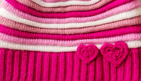 Knitted pattern with hearts Stock Photos