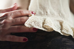 Knitted pattern, macrame original textile texture. And woman hand Stock Photography