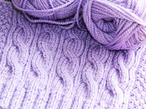 Knitted pattern with needles and ball of yarn two Royalty Free Stock Photos