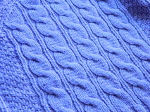 Knitted pattern with needles Royalty Free Stock Image