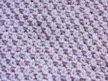 Knitted pattern with needles Royalty Free Stock Photography