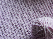Knitted pattern with needles Royalty Free Stock Photo