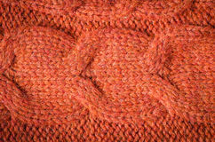 Knitted pattern. Orange knitted background of loops Stock Photo