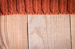 Knitted pattern. Orange knitted background of loops Stock Image