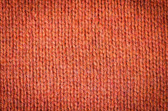 Knitted pattern. Orange knitted background of loops Royalty Free Stock Images