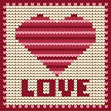 Knitted  pattern with red heart. Royalty Free Stock Photos