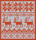 Knitted pattern with reindeer and jacquard flowers Stock Images