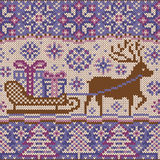 Knitted pattern with reindeer and sleigh Royalty Free Stock Images