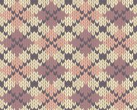 Knitted pattern with rhombus Royalty Free Stock Photo