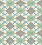 Knitted pattern with rhombus. Seamless knitted pattern for winter clothing. EPS 8 vector illustration Stock Images