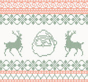 Knitted pattern with santa claus and deer Stock Photos