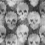 Knitted pattern with the skulls and melange effect Royalty Free Stock Photos