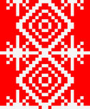 Knitted pattern with snowflakes. Red winter background. Red vector winter background with white squares Royalty Free Stock Photos