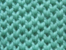 Knitted pattern spokes `Honeycomb`. Turquoise, mint pattern Royalty Free Stock Photos