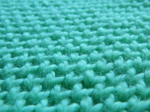 Knitted pattern spokes `Honeycomb`. Turquoise, mint pattern Stock Photos