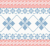 Knitted pattern with swirl and star Stock Images