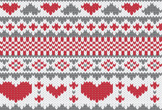 Knitted pattern vector with hearts Royalty Free Stock Photos