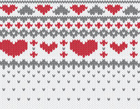 Knitted pattern vector with hearts Royalty Free Stock Image