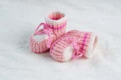 Knitted pink baby boots Royalty Free Stock Photos