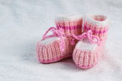Knitted pink baby boots Royalty Free Stock Image