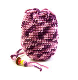 Knitted pink tone bag and bead on white background Stock Images