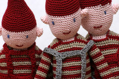 Knitted pixies. Three knitted pixies Royalty Free Stock Photo