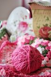 Knitted blanket from pink yarn stock image