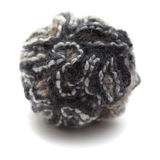 Knitted pompom of variegated yarn Royalty Free Stock Image
