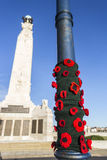 Knitted poppies at the Portsmouth Naval Memorial Extension Stock Photos