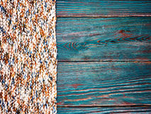 Knitted product carpet plaid close up of fiber of thread texture wool wooden background board floor brown green Stock Photos