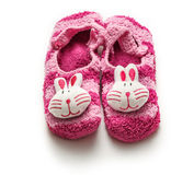 Knitted purple booties with rabbit Royalty Free Stock Photography