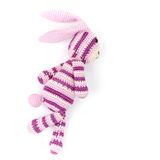 Knitted rabbit toy is running fast, closeup photo Stock Photos