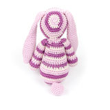 Knitted rabbit toy sitting isolated on white background Royalty Free Stock Image