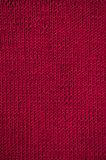 Knitted red canvas pattern Royalty Free Stock Photo