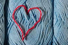 Knitted red heart on blue Royalty Free Stock Photos