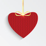Knitted red heart with golden ribbon Stock Photos