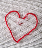 Knitted red heart on white Stock Photography