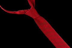 Knitted red necktie Stock Image