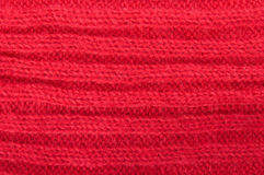Knitted red wool fabric Stock Image