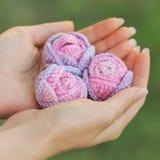 Knitted rose melange yarn handmade Stock Photo
