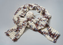 Knitted scarf with knitting needles Royalty Free Stock Image